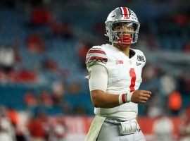 Ohio State quarterback Justin Fields saw his 2021 NFL Draft stock tank over the last few weeks, but with so many teams in need of a quarterback, he should still get selected in the middle of the first round. (Image: Mark J Rebilas/USA Today Sports)