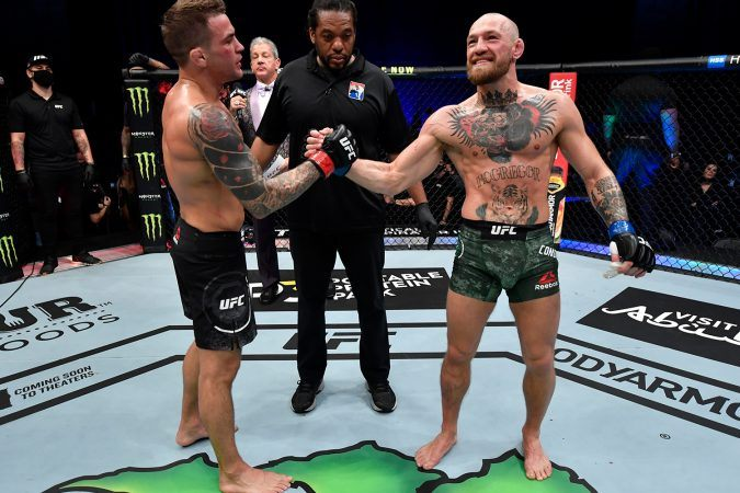 Dustin Poirier (left) and Conor McGregor (right) will meet up for a third time when the two fight at UFC 264 in Las Vegas this summer. (Image: Jeff Bottari/Zuffa/Getty)