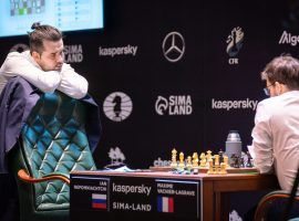 Ian Nepomniachtchi (left) secured a draw against Maxime Vachier-Lagrave (right) on Monday, which was enough to clinch victory in the Candidates Tournament. (Image: Lennart Ootes/FIDE)