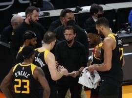 Quin Snyder, the head coach of the Utah Jazz seen here drawing up a play in a timeout, is the co-favorite to win NBA Coach of the Year. (Image: Rob Gray/USA Today Sports)