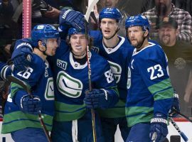 The Vancouver Canucks have stopped playing and practicing as the team deals with the worst NHL COVID-19 outbreak yet this season. (Image: Rich Lam/Getty)