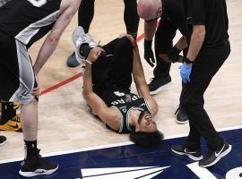 San Antonio Spurs guard Derrick White cringes in pain after he suffered an ankle injury against the Washington Wizards. (Image: Nick Wass/AP)