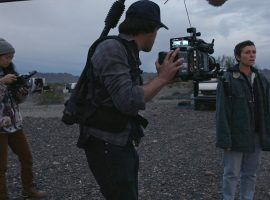 Director Chloe Zhao (left), seen here on set of Nomadland with France McDermott, is the favorite to win multiple categories at the 2021 Oscars. (Image: Fox Searchlight Pictures)