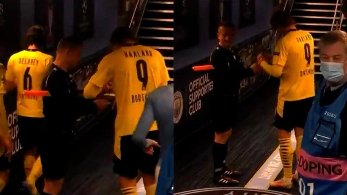 Erling Haaland signing Sovre's cards after Man City - Dortmund in the Champions League