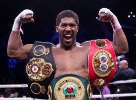 Anthony Joshua (pictured) and Tyson Fury are closing in on an August date for their heavyweight title unification bout. (Image: Getty)