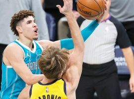 Charlotte Hornets rookie point guard LaMelo Ball drives to the basket against Domantas Sabonis from the Indiana Pacers. The Pacers and Hornets square off in the NBA Play-in Tournament in the Nine-Ten Game. (Image: Jared C. Tilton/Getty)