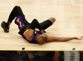 Chris Paul of the Phoenix Suns fell to the floor with a shoulder injury during the second quarter of Game 1 against the LA Lakers. (Image: Getty)