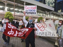 Demonstrators protest against holding the Tokyo Summer Olympics this summer during a May 17, 2021 rally. (Image: Koji Sasahara/AP)