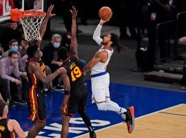 Derrick Rose of the New York Knicks penetrates the paint against Tony Snell of the Atlanta Hawks in Game 1 of the opening-round of the Eastern Conference playoffs. (Image: Peter Carini/Getty)