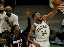 Giannis 'Greek Feak' Antetokounmpo of the Milwaukee Bucks elevates over Bam Adebayo from the Miami Heat. (Image: Getty)
