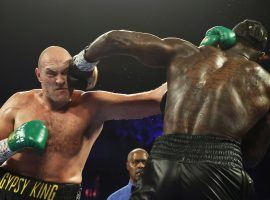 An arbitrator has ruled that Tyson Fury (left) must grant a rematch to Deontay Wilder (right) by Sept. 15. (Image: Getty)