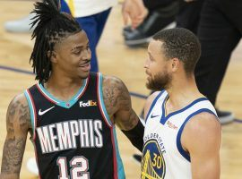 Ja Morant of the Memphis Grizzlies and Steph Curry from the Golden State Warriors during the final game of the regular season. (Image: Getty)
