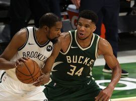 Giannis 'Greek Freak' Antetokounmpo (right) from the Milwaukee Bucks defends Brooklyn Nets big man Kevin Durant during a game among two of the premier teams in the Eastern Conference. (Image: Getty)