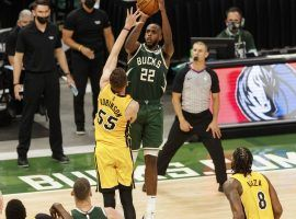Khris Middle of the Milwaukee Bucks pulls up for a game-winning shot in overtime to edge out the Miami Heat in Game 1 of their first-round series in the NBA playoffs. (Image: Jeff Hanisch/USA Today Sports)