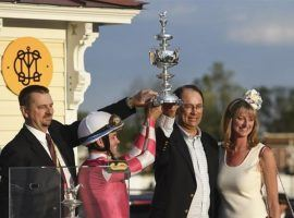 Rombauer trainer Mike McCarthy, jockey Flavien Prat and owners John and Diane Fradkin hoist the Woodlawn Vase replica after Rombauer's Preakness Stakes victory Saturday. The colt heads to Belmont Park for a likely date in the June 5 Belmont Stakes. (Image: AP Photo/Will Newton)