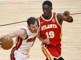 Tony Snell (19) of the Atlanta Hawks defends Goran Dragic of the Miami Heat during Southeast Division action. (Image: Rhona Wise/USA Today Sports)