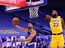 Steph Curry of the Golden State Warriors attempt a layup against LeBron James of the LA Lakers earlier this season at the Chase Center in San Francisco. (Image: Noah Graham/Getty)