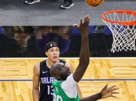 Tacko Fall of the Boston Celtics drives to the basket against Orlando Magic center Mo Bomba in a blowout in which he recorded four blocked shots in less than a minute. (Image: Getty)