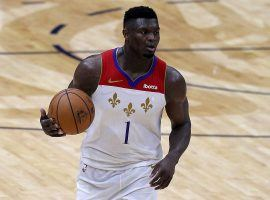 Zion Williamson dribbles up the court in a victory for the New Orleans Pelicans over the Golden State Warriors in his final game of the season before a finger injury prematurely ended his season. (Image: Sean Gardner/Getty)