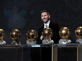 Lionel Messi poses with his six 'Ballon d'Or' trophies. (Image: forbes.com)