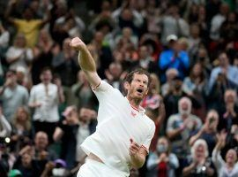 Andy Murray won his first-round match on Monday, marking his first win at Wimbledon in four years. (Image: Kristy Wigglesworth/AP)