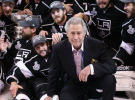 AEG founder Philip F. Anschutz poses with the team and the Stanley Cup after defeating the New Jersey Devils in Game Six of the 2012 Stanley Cup Finals at Staples Center on June 11, 2012 in Los Angeles, California. The Kings defeated the Devils 6-1 to win the series 4 games to 2.  (Image: Christian Petersen/Getty)
