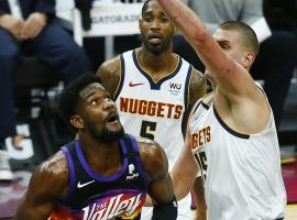 Deandre Ayton of the Phoenix Suns attempts a shot against Nikola Jokic from the Denver Nuggets in an early-season meeting in January. (Image: USA Today Sports)