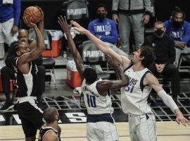 Kawhi Leonard of the Los Angeles Clippers shoots over Dorian Finney-Smith (10) and Boban Marjanovic (51) during Game 5 at the Staples Center in LA. (Image: LA Times)