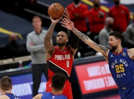 Damian Lillard of the Portland Trail Blazers, seen here elevating for one of his record-setting 12 3-point shots, evades Austin Rivers of the Denver Nuggets. (Image: Porter Lambert/Getty)