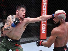 Brandon Moreno (left) will get a second shot at flyweight champion Deiveson Figueiredo at UFC 263 on Saturday. (Image: Jeff Bottari/Zuffa/Getty)