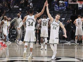 Giannis 'Greek Freak' Antetokounmpo and Pat Connaughton of the Milwaukee Bucks celebrate their series win in seven games against the Brooklyn Nets. (Image: Nathaniel S. Butler/Getty)