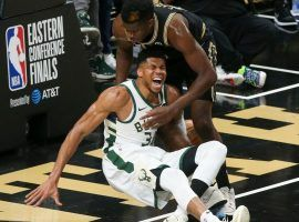 Giannis Antetokounmpo from the Milwaukee Bucks screams after suffering a knee injury while trying to block a dunk by Clint Capela (right) of the Atlanta Hawks in Game 4 of the Eastern Conference Finals. (Image: Getty)