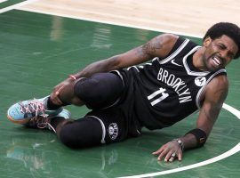 Brooklyn Nets guard Kyrie Irving grimaces in pain with an ankle injury during the second quarter of Game 4 of the Eastern Conference Semifinals against the Milwaukee Bucks at Fiserv Forum. (Image: Getty)