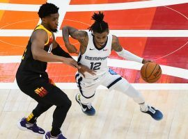 Donovan Mitchell of the Utah Jazz defends Ja Morant (12) from the Memphis Grizzlies in Game 2 when Morant erupted for 27 points in a loss. (Image: Getty)