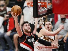 Jusuf Nurkic of the Portland Trail Blazers scoops a layup against Nikola Jokic of the Denver Nuggets in Game 4 at the Moda Center in Portland. (Image: Steph Chambers/Getty)