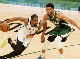 Kevin Durant of the Brooklyn Nets drives by Giannis 'Greek Freak' Antetokounmpo from the Milwaukee Bucks when the two teams met in May at Fiserv Forum in Milwaukee. (Image: Getty)