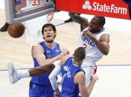 Kawhi Leonard of the LA Clippers throws down a monster dunk over the Texas Towers – 7-foot-4 Boban Marjanovic and 7-foot-3 Kristaps Porzingis – from the Dallas Mavericks in Game 6. (Image: Getty)
