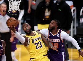 LeBron James of the Los Angeles Lakers scoops a layup under Jae Crowder of the Phoenix Suns during Game 3 at Staples Center in downtown LA. (Image: Sean M. Haffey/Getty)