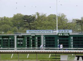 The Monmouth Park toteboard is due for some changes on the win-place-show side when fixed-odds wagering takes effect. New Jersey Gov. Phil Murphy is expected to sign the bill legalizing fixed-odds horse wagering in time for the July 17 Haskell Stakes. (Image: Seth Wenig/AP Photo)