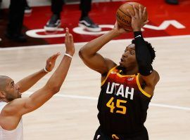 Donovan 'Spida' Mitchell from the Utah Jazz hoists a 3-point shot over Nicolas Batum from the LA Clippers in Game 1 of the Western Conference semifinals in Salt Lake City. (Image: Jeffrey Swing/UAS Today Sports)