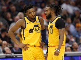 Utah Jazz backcourt players -- Donovan Mitchell and Mike Conley -- discuss strategy during a 2020 game in Utah. (Image: Rich Pedroncelli/AP)