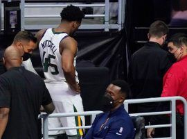 Donovan Mitchell from the Utah Jazz limps off to the locker room after an ankle injury in the fourth quarter of Game 3 against the LA Clippers at the Staples Center in LA. (Image: Peter Carini/Getty)