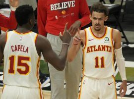 Clint Capela (15) of the Atlanta Hawks congratulates teammate Trae Young after dropping 48 points against the Milwaukee Bucks in a Game 1 victory at the Fiserv Forum in Milwaukee. (Image: Getty)