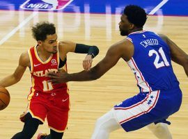 Trae Young of the Atlanta Hawks scoots by Joel Embiid from the Philadelphia 76ers. (Image: James Lang/USA Today Sports)