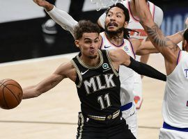 Trae Young of the Atlanta Hawks drives the lane against Derrick Rose and Obi Toppin from the New York Knicks in Game 4 at State Farm Arena in Atlanta. (Image: Getty)