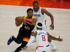 Donovan 'Spida' Mitchell of the Utah Jazz splits a pair of LA Clippers, Kawhi Leonard (2) and Monte Morris (8) in Game 2 in Salt Lake City. (Image: Rock Browner/Getty)