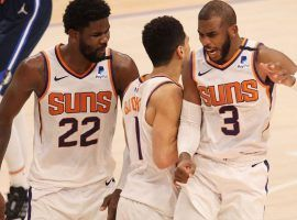 Deandre Ayton (22), Devin Booker (1), and Chris Paul (3) of the Phoenix Suns are the favorites heading into Game 1 of the 2021 NBA Finals against the Milwaukee Bucks. (Image: Matt York/AP)