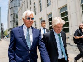 Hall of Fame trainer Bob Baffert (left), shown here leaving federal court during a Monday hearing, had his indefinite suspension by the New York Racing Association ruled unconstitutional. A Brooklyn judge said the suspension violated the trainer's due process rights. (Image: AP File Photo/John Minchillo)