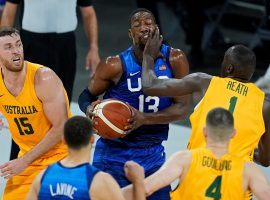 Bam Adebayo from Team USA takes a smack in the face from Duop Reath on Australia in an exhibition game and Olympics warm up at Mandalay Bay in Las Vegas. (Image: John Locher/AP)