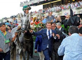 Celebrity chef/restauranteur Bobby Flay shepherds Creator into the 2016 Belmont Stakes winner's circle. A horse aficionado and owner, Flay bought a majority share in filly Caravel, who runs Saturday in the Caress Stakes at Saratoga. (Image: Anne M. Eberhardt)
